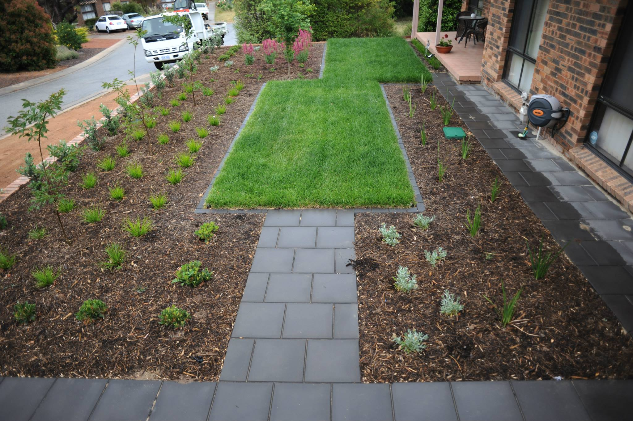 Cousin Place, ACT. Turfing, Gardening and Paving 3