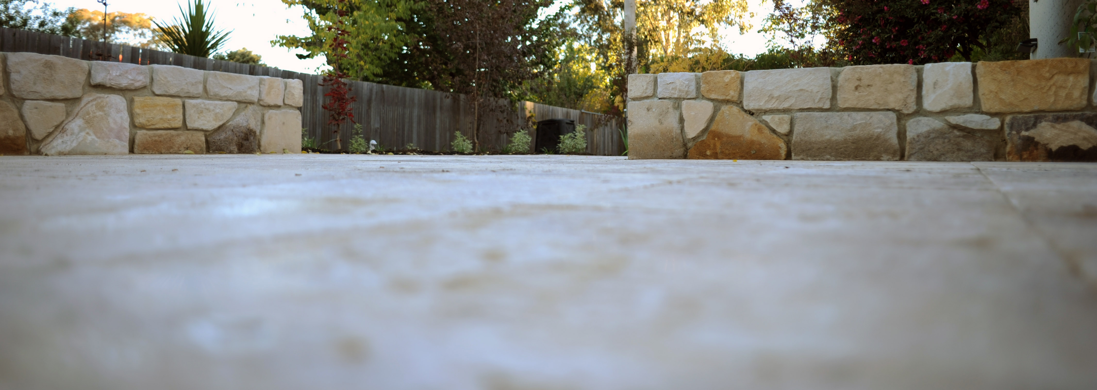 Bromell Circuit, ACT. Close-up of the new pavers and stone walls in the background