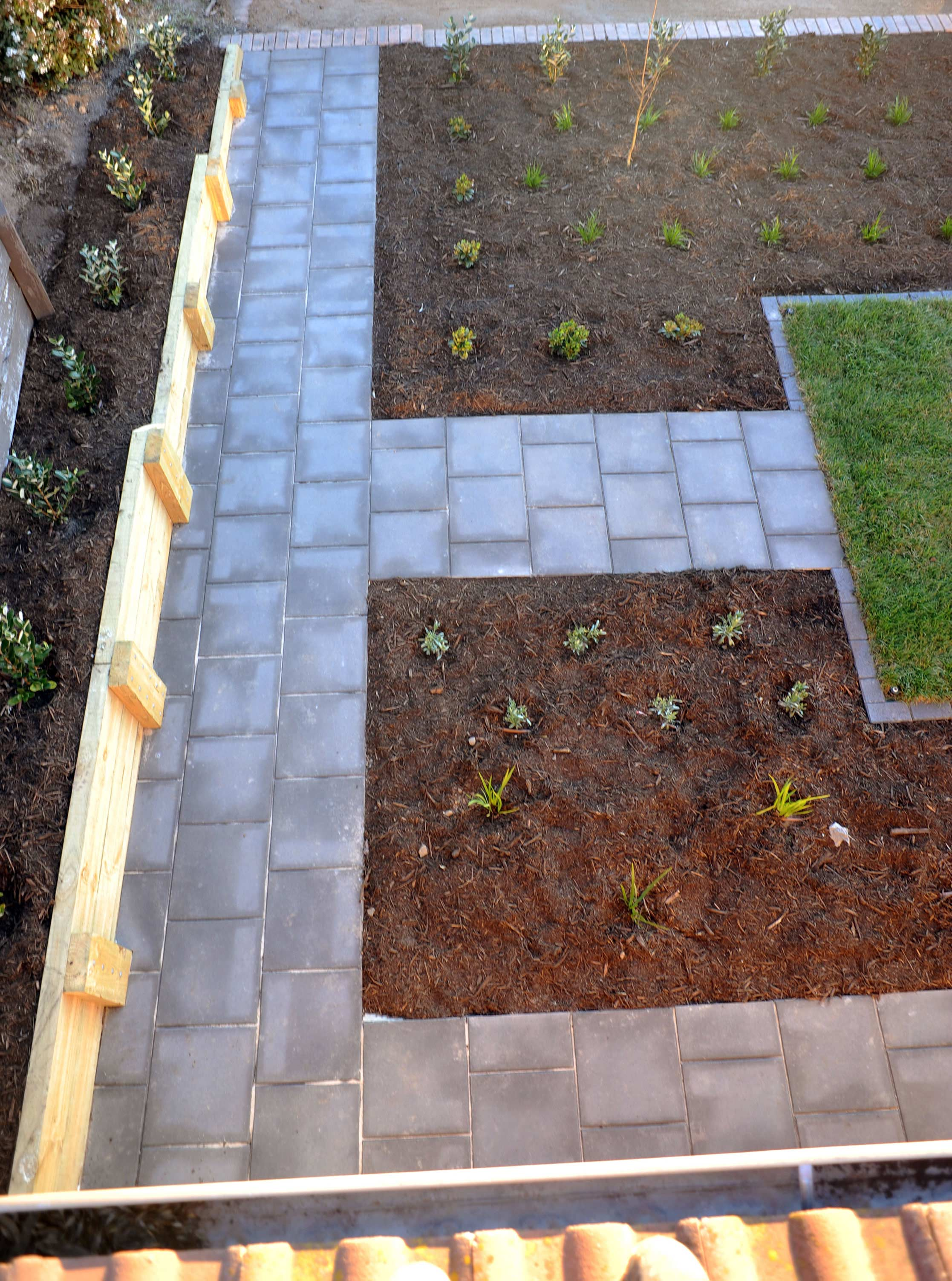 Cousin Place, ACT. Turfing, Gardening and Paving 5